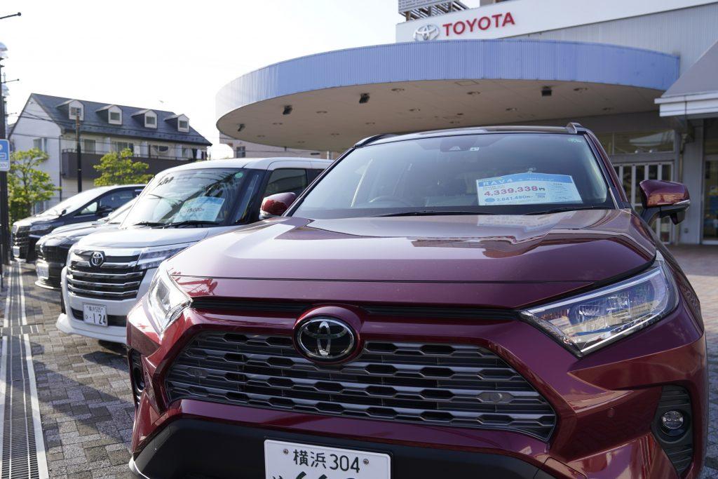 A red Toyota Motor Corp. RAV4 sports utility vehicle (SUV) at the company's dealership in Yokohama, Japan