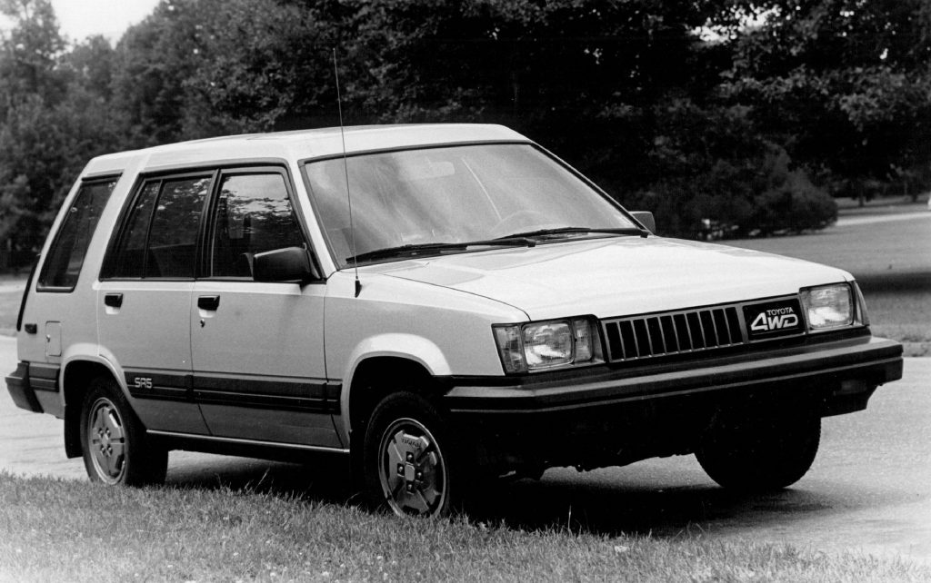 A black and white photo of the 1985 Toyota Tercel in a field.