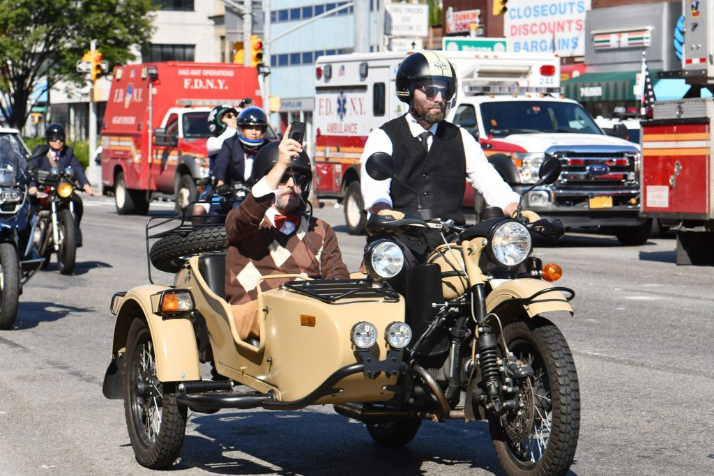 Two riders on a tan Ural motorcycle at the 2018 Distinguished Gentleman's Ride in New York City