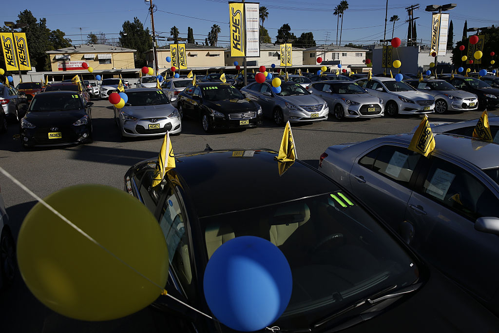 used car dealership with flags and ballons
