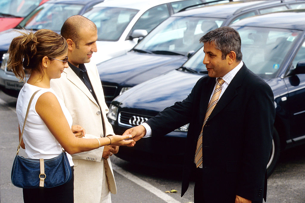 used car dealer shaking on the deal