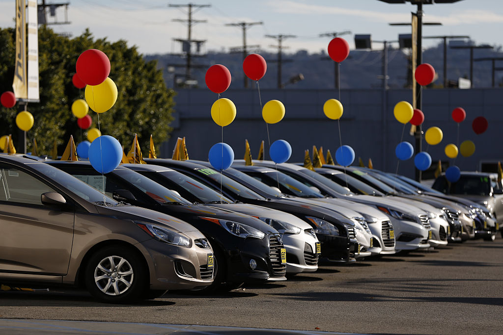 used car dealer with colorful ballons