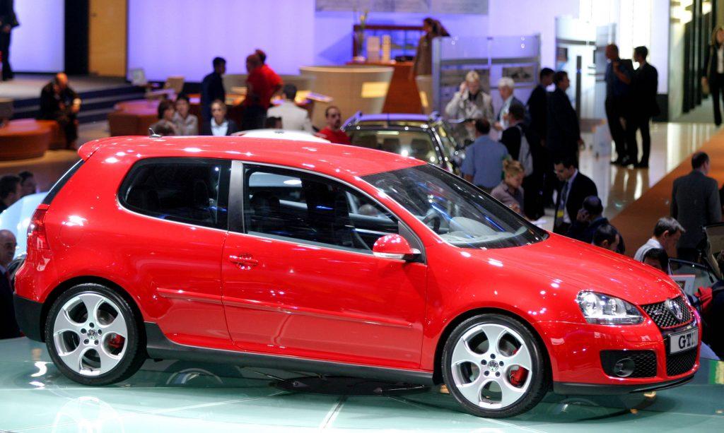 A red Volkswagen Golf 5 three door hatchback