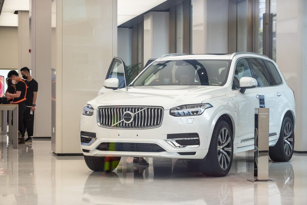 One of the safest midsize luxury SUVs, a Volvo XC90 on a display showroom floor.