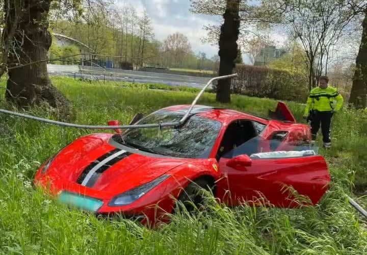 wrecked red Ferrari 488 Pista after crash