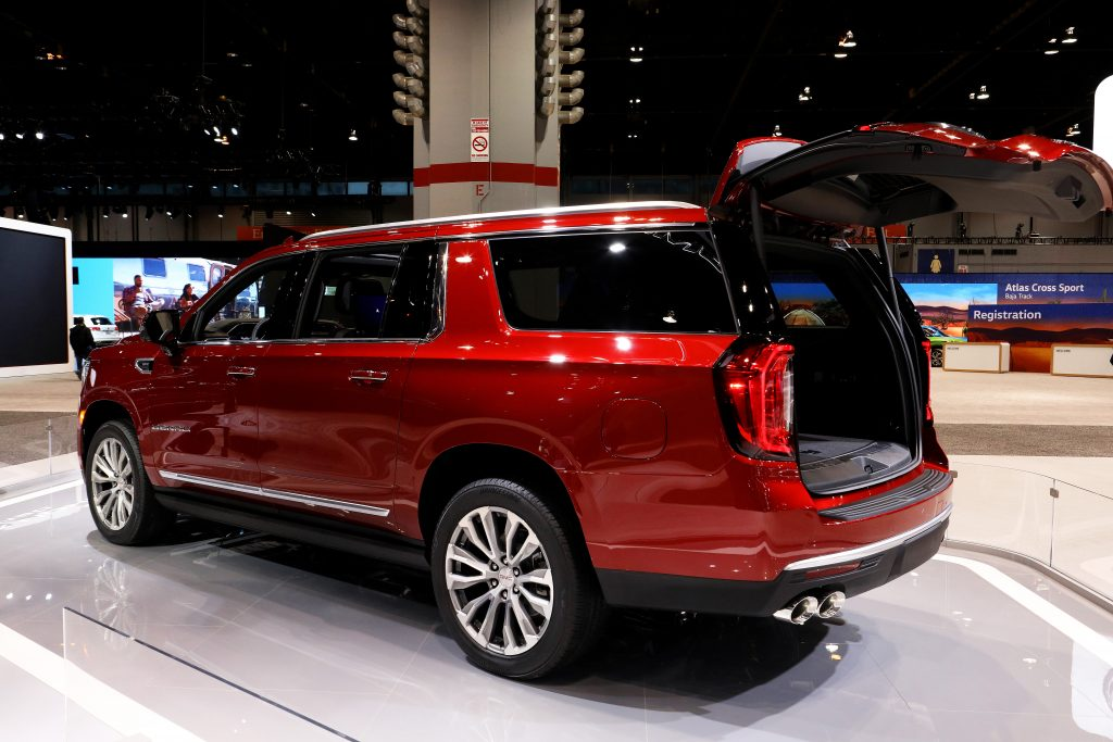 A 2021 GMC Denali Yukon at a car show. The Yukon is similar to the Chevy Suburban, but which is safer?