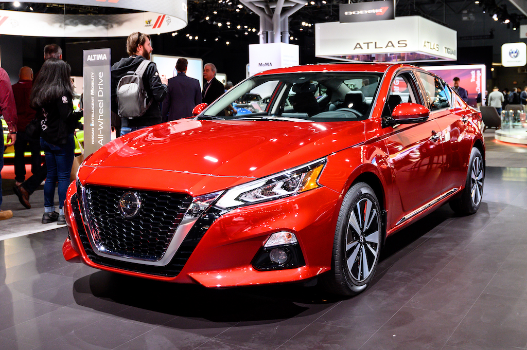a red nissan altima on display