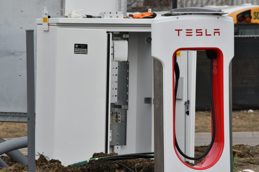 Electrical contractors work on installing the wiring on Tesla supercharger stations