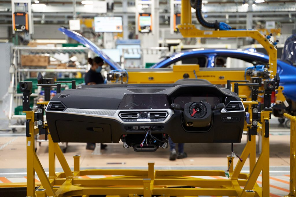 A partially assembled BMW dash on the assembly line in their factory