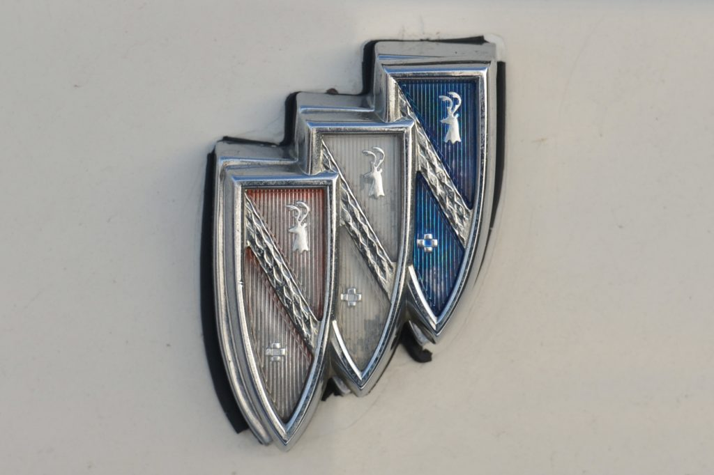 A faded red, white, and blue Buick logo emblem