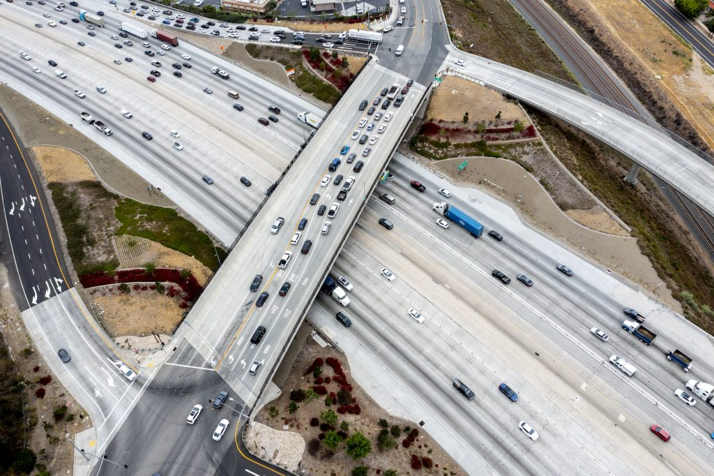 An aerial view of traffic on the 91 Freeway and the Green River Road overpass on May 20, 2021, in Corona, California