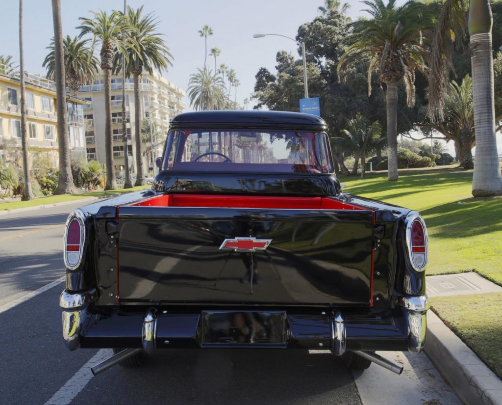back of a black 1956 chevy 3100 pickup truck