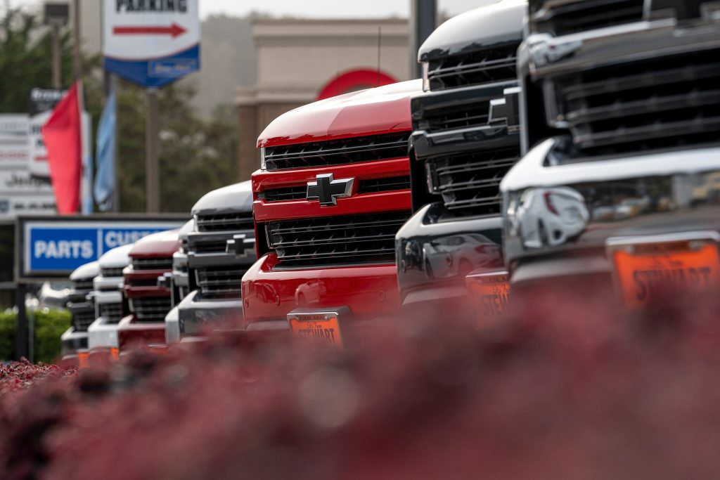 A lineup of Chevrolet Silverado 1500s at the dealership