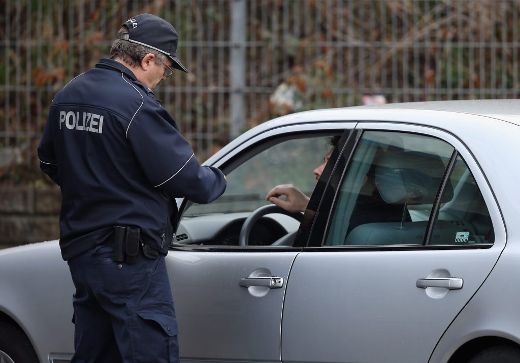 A policeman pulls over a car caught for speeding during a city-wide police action to catch people for speeding and other traffic infringements.