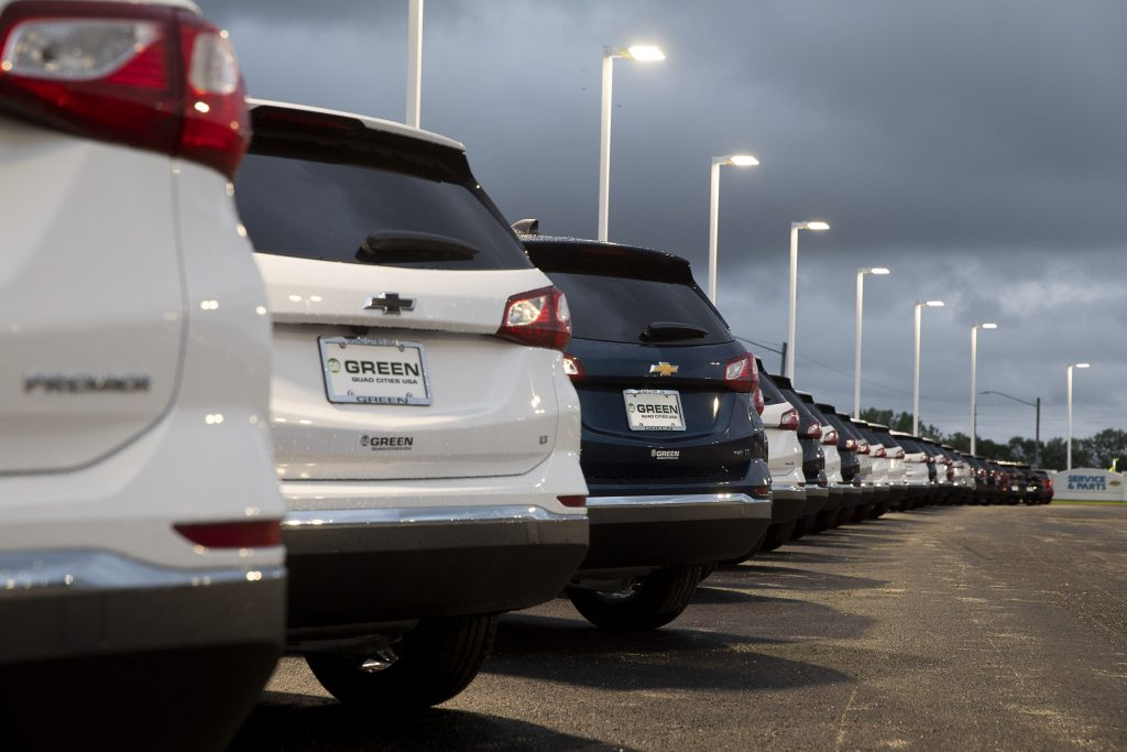 A line of cars at a car dealership.