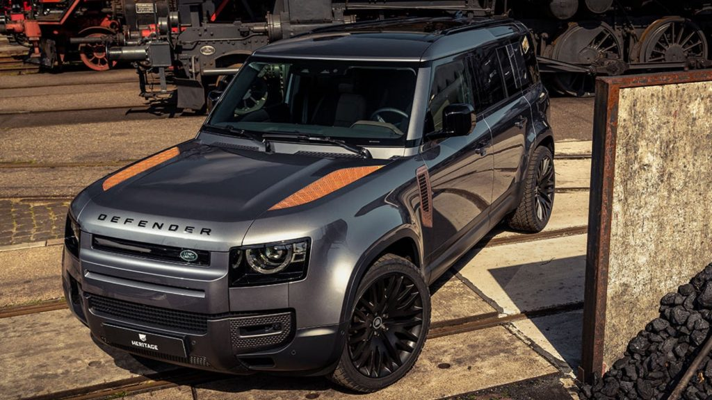 zoomed out photo of a Defender with custom rusted trim