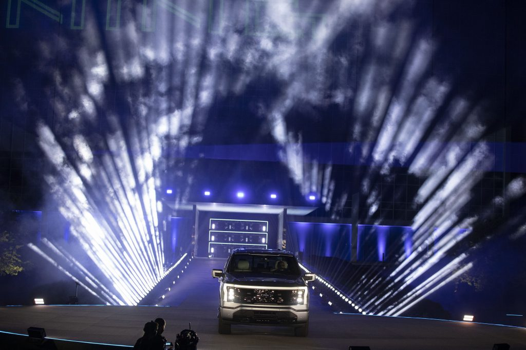 The Ford F-150 debuts amidst flashing lights.