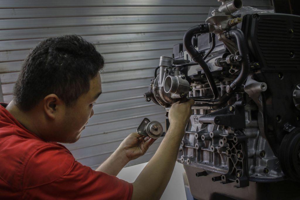 A mechanic rebuilding an engine