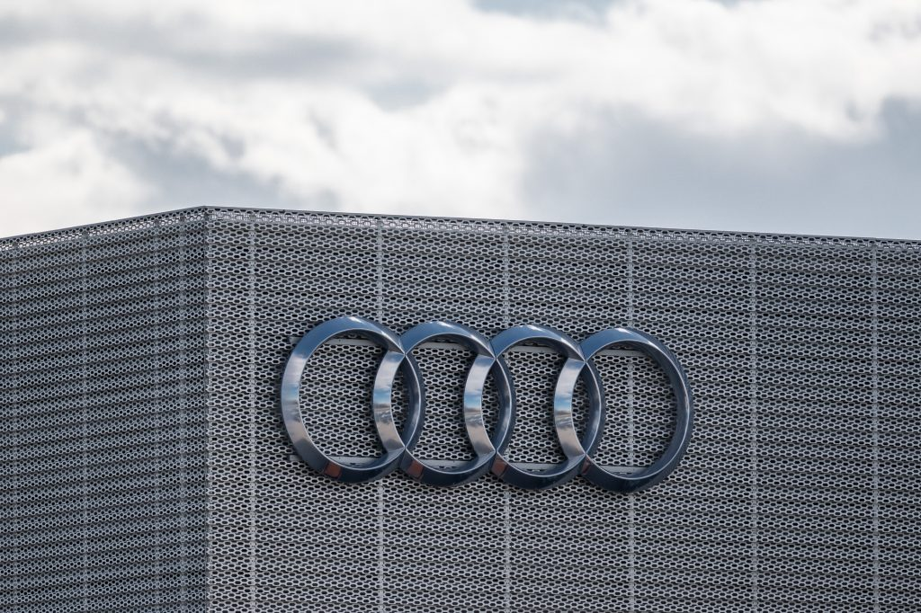 The exterior of Audi's office in Gdansk, showing their four rings logo on the corner of the building.