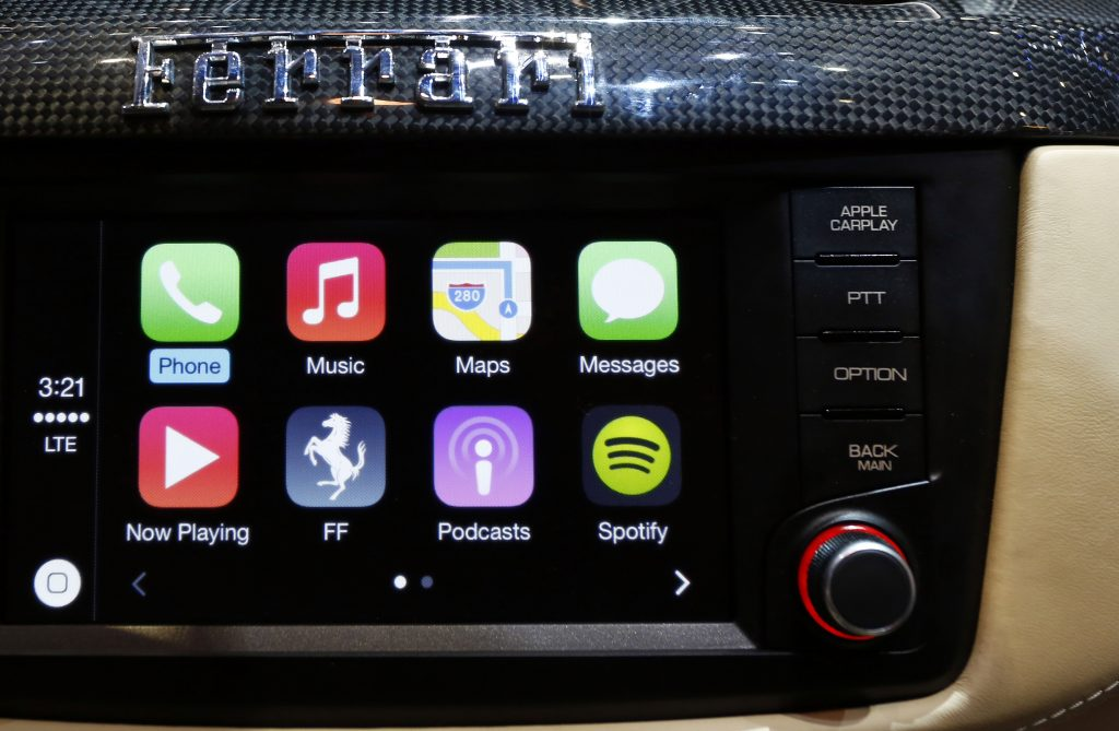 Apple CarPlay shown on the infotainment screen of a new Ferrari FF
