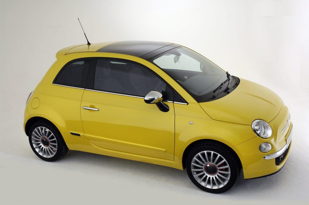 A yellow FIat 500 three door hatchback