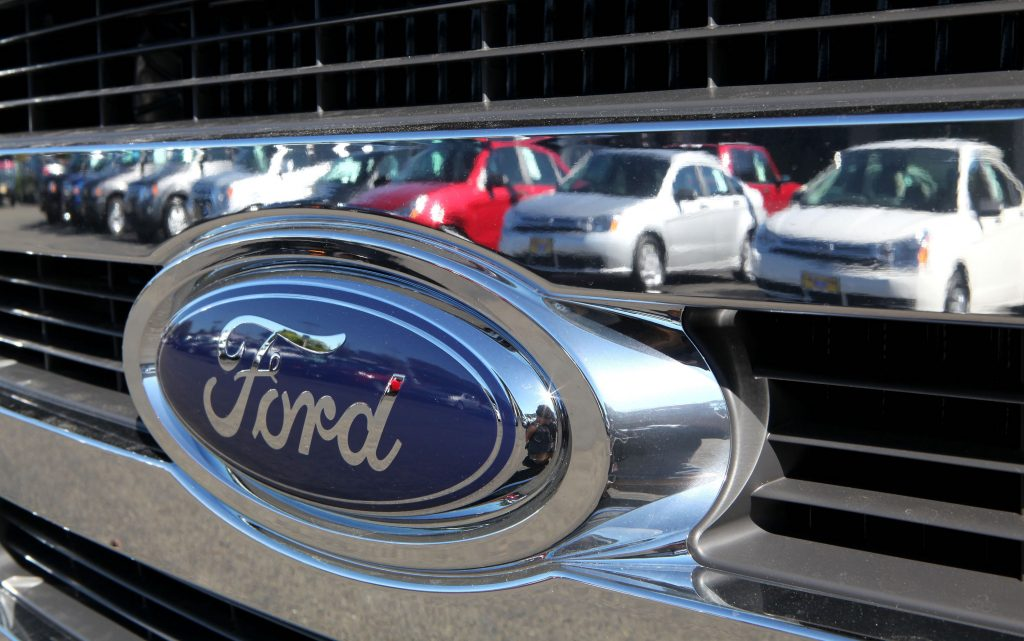 Ford cars reflected in the chrome bumper of a Ford car