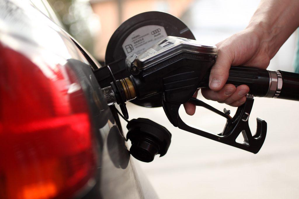 A gas pump fills up a gas tank