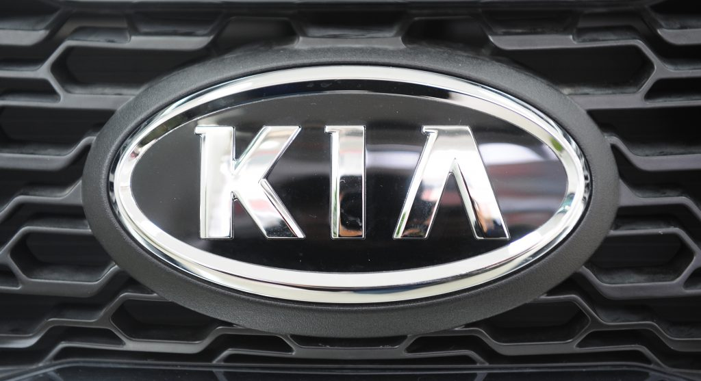 A kia badge on the front grille of a kia forte