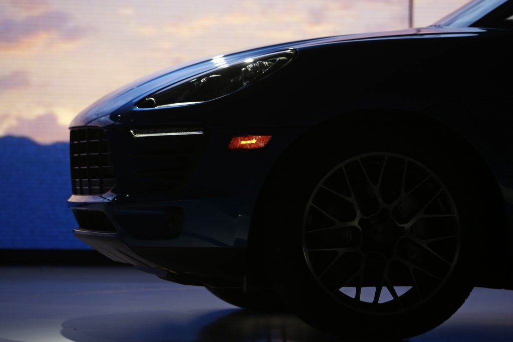 A shadowy photograph of the nose of the Porsche Macan , highlighting the body lines of the car.