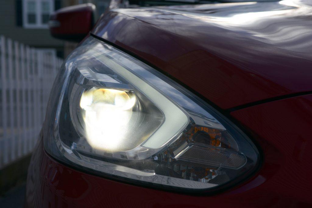 A dull looking headlights of a mitsubishi mirage