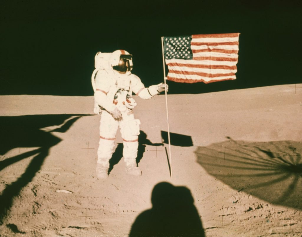 Astronaut Alan B Shepard  on the surface of the moon during the Apollo 14 mission. GM is sending a lunar rover to the moon.