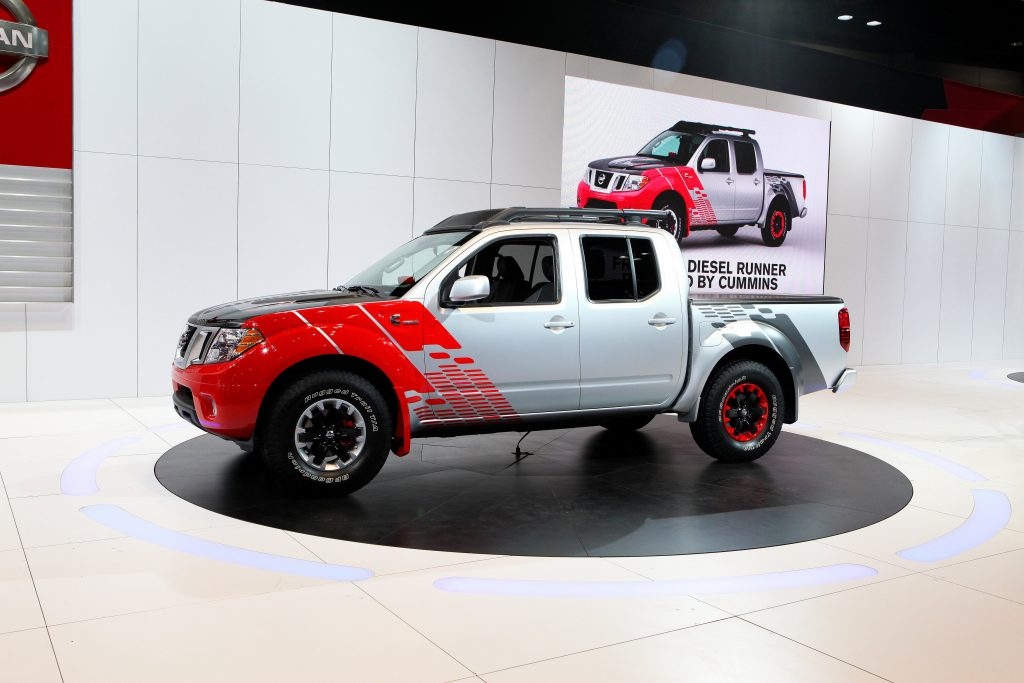A silver and red 2014 nissan frontier