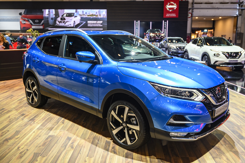 A blue nissan rogue on display