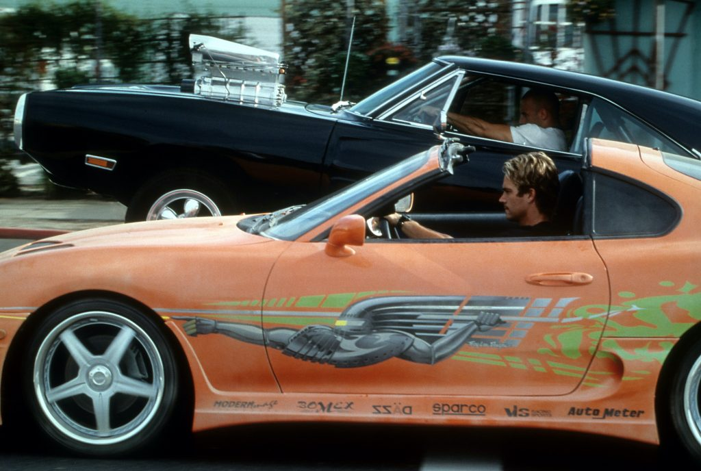 Vin Diesel and Paul Walker racing against each other in a scene from the film 'The Fast And The Furious.