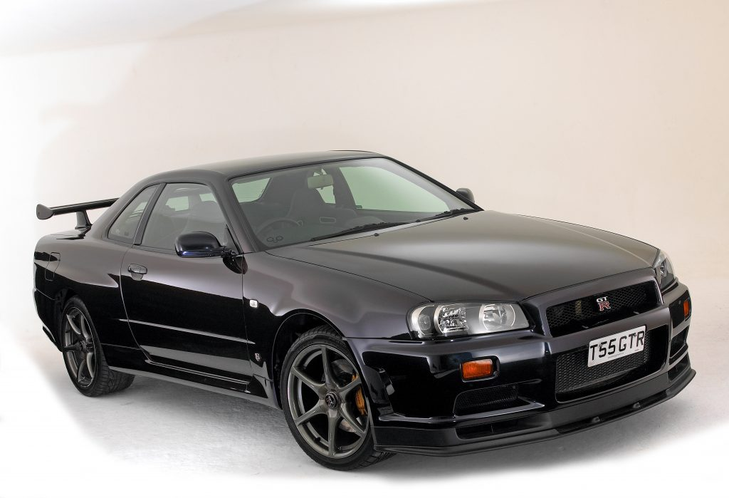 An image of a Nissan Skyline GT-R parked in a photo studio.