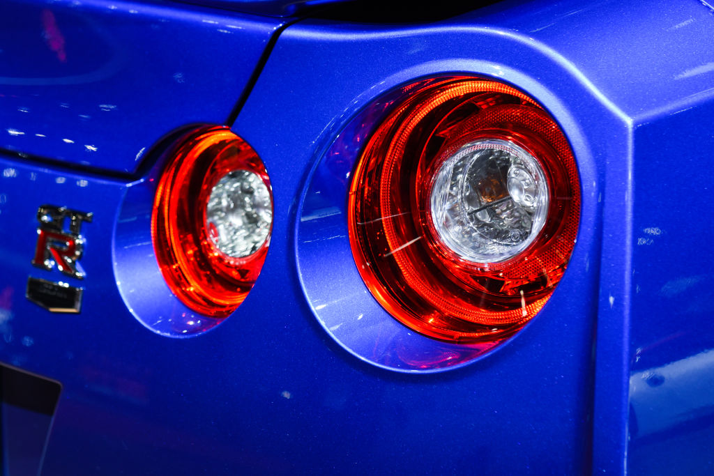 An image of the tail lights on a Nissan Skyline GT-R at a auto show.