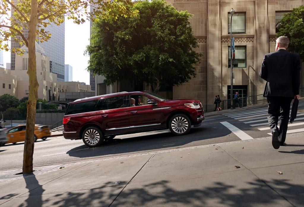 A 2021 Lincoln Navigator driving through a city.