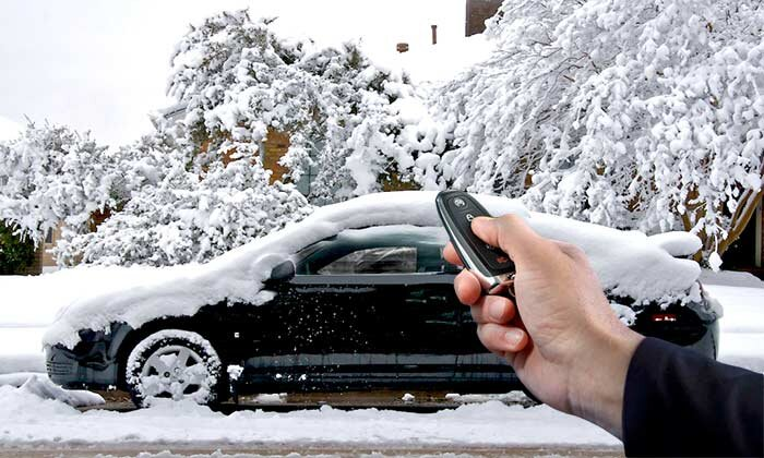 A car being remotely started in the snow