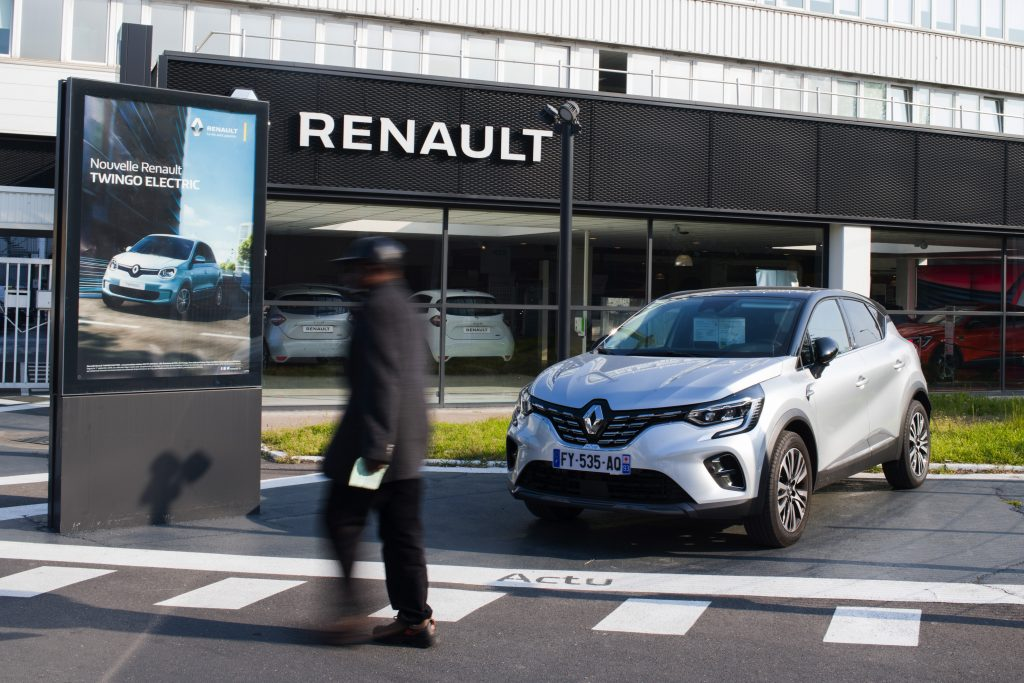 A man walks in to a Renault dealership