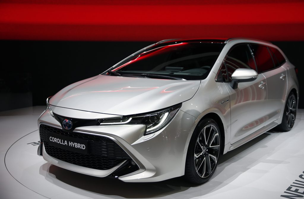 A silver Toyota Corolla shown under the lights at the Paris Motor Show