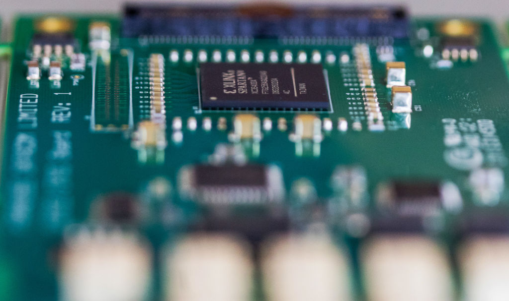 A semiconductor sits on a circuit board.