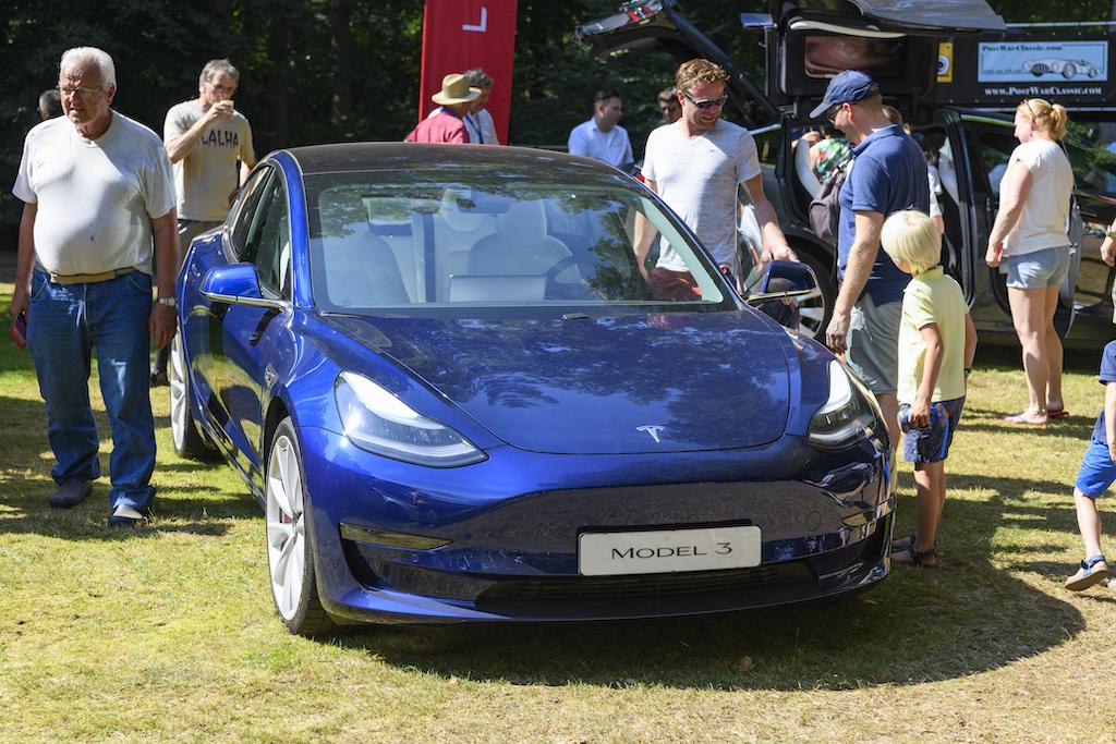 Blue Tesla Model 3 on display