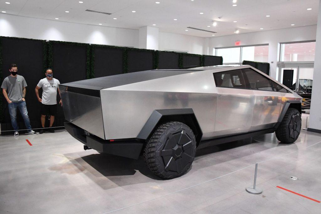 A steele Tesla Cybertruck electric pickup on display indoors