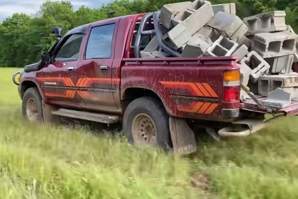 Toyota Hilux import with a bed full of cinderblocks