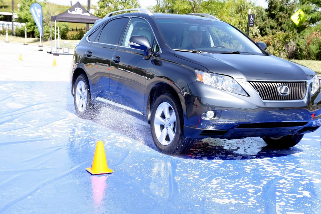 A black Lexus RX 350 SUV performing traction testing