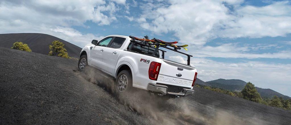 A 2021 Ford Ranger climbs a dirt hill.