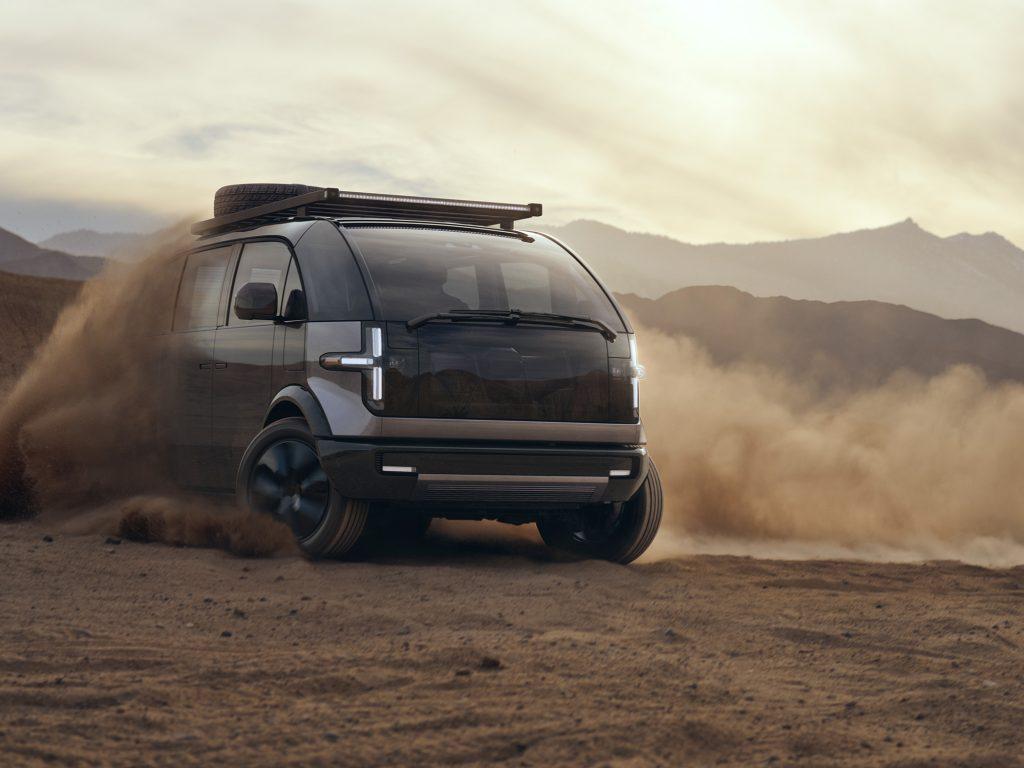 The 2022 Canoo Lifestyle van kicking up dirt