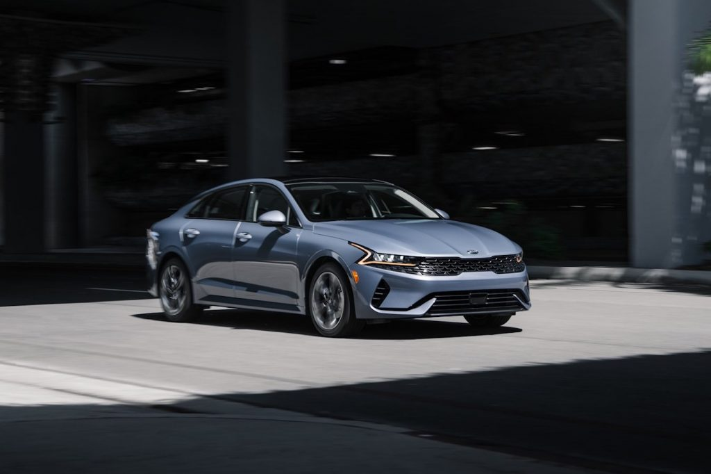 2021 Kia K5 reviewed by Consumer Reports in grey parked on a city street
