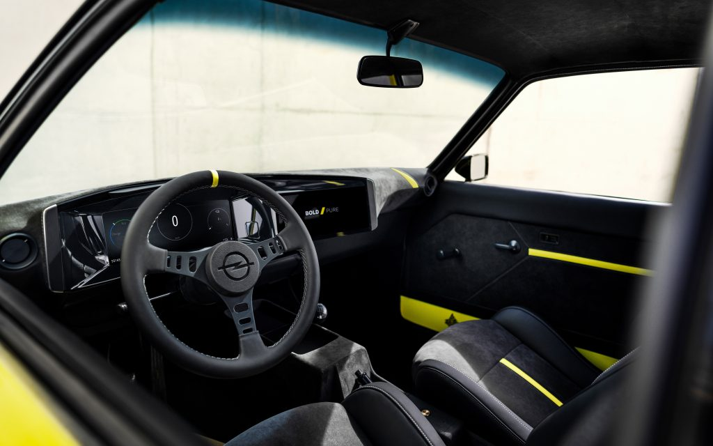 The interior of the Opel Manta GSe with yellow accents on the seats and doors
