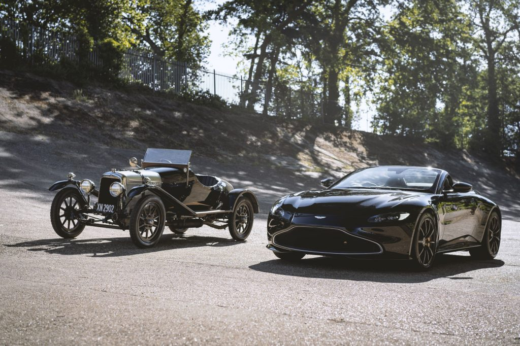 The black 1921 Aston Martin A3 next to the black Q by Aston Martin Vantage Roadster at the Brooklands circuit